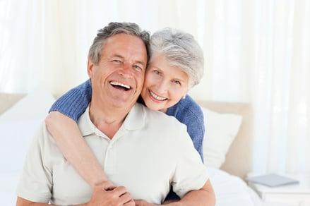 Senior couple looking at the camera  at home