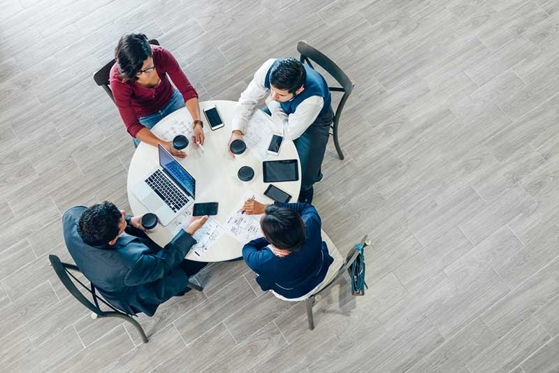 Professionals at a table networking